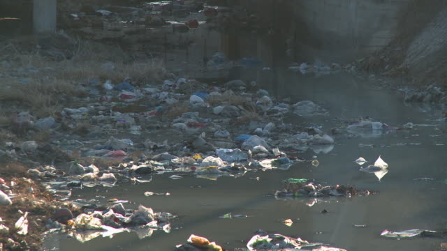 ms ditch or stream full of litter, beijing, china - water pollution stock videos & royalty-free footage