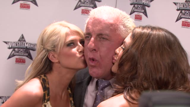 WWE Diva Kelly Kelly Ric 'Nature Boy' Flair and WWE Diva Eve at the WrestleMania 25th Anniversary Press Conference at New York NY