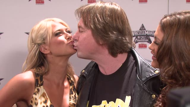 WWE Diva Kelly Kelly 'Rowdy' Roddy Piper and WWE Diva Eve at the WrestleMania 25th Anniversary Press Conference at New York NY