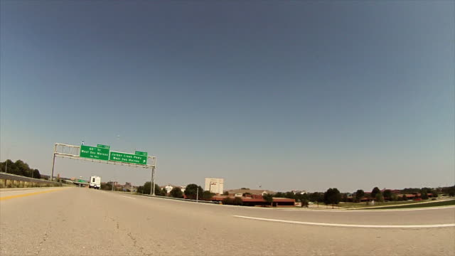 Dive along interstate with exit signs, West Des Moines and Jordan Crossing