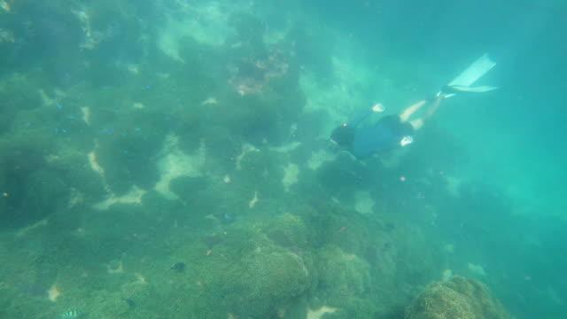 Diver in deep blue sea