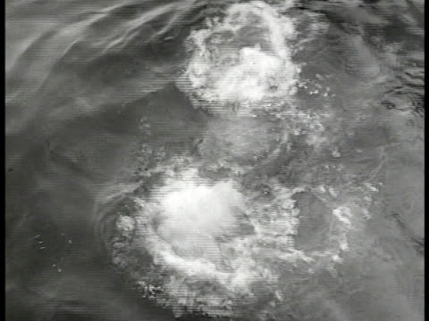 stockvideo's en b-roll-footage met diver in suit submerging under water w/ welding tool ms divers working under water welding beam ws french workers repairing ships in dry dock ms... - 1946