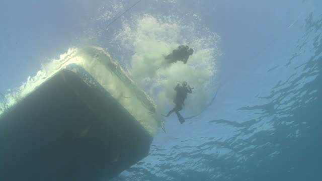 diver jump in, red sea, egypt - aqualung diving equipment stock videos & royalty-free footage