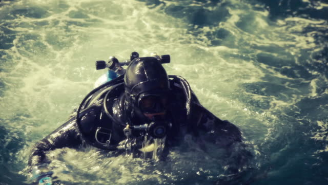 Diver preparing to go into water