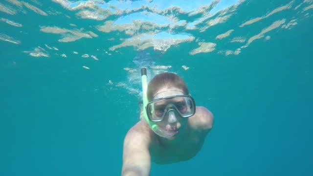 POV Diver swimming underwater