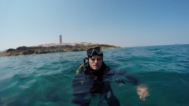pov diver taking selfie on a surface - underwater diving stock videos & royalty-free footage
