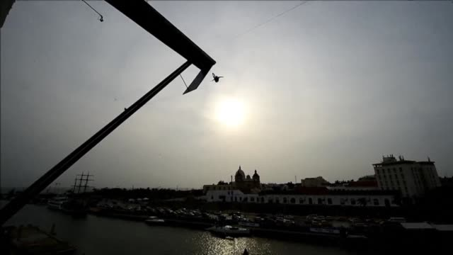 divers compete from a 27 meter high platform during the final of red bull cliff diving world series 2015 in cartagena - diving platform stock videos & royalty-free footage