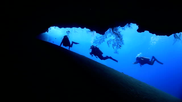 divers explore - cave stock videos & royalty-free footage