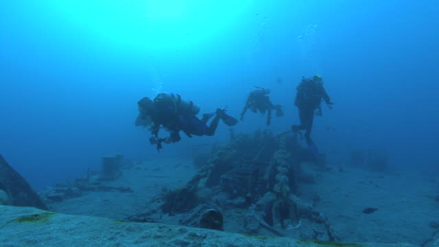 divers over bow on Thistlegorm, Red sea, Egypt