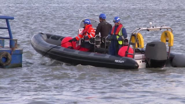 Divers search for unexploded World War 2 bombs in River Thames Dive team along in boat River boat Crane on barge Worker beside crane Mark Willbourn...