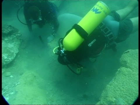 divers working on underwater construction in israel - tauchgerät stock-videos und b-roll-filmmaterial