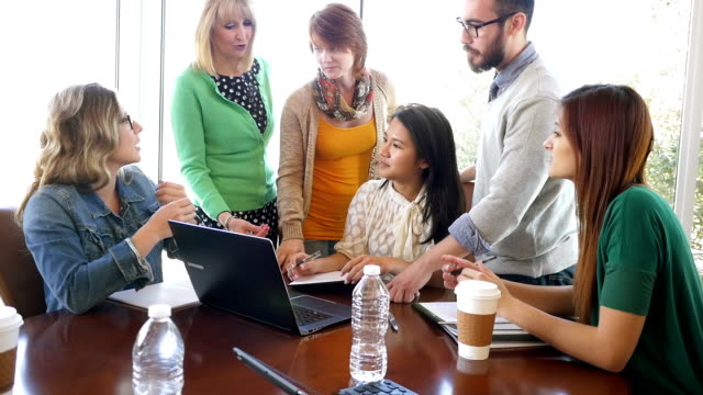 Diverse business team meeting to work on creative project in modern office