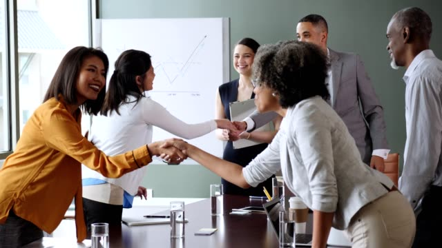 diverse businesspeople greet one another before meeting - board room stock videos & royalty-free footage