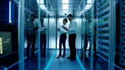 Diverse colleagues with tablets in data center