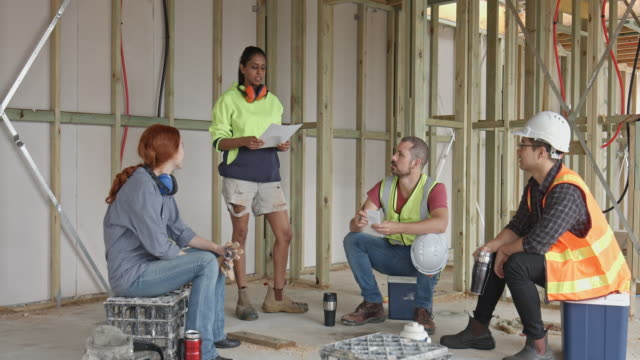 diverse construction workers on the coffee break - safety stock videos & royalty-free footage