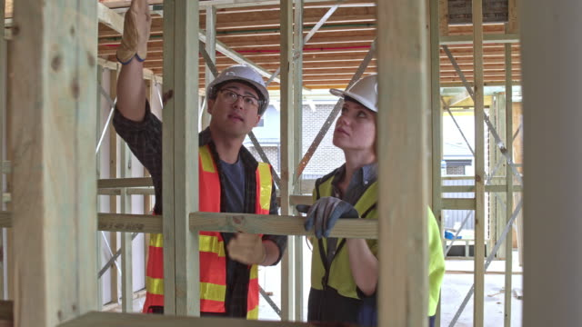 diverse construction workers talking about the next job to do - construction stock videos & royalty-free footage