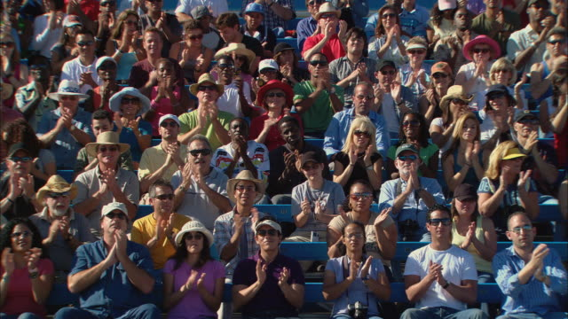 HA WS PAN Diverse crowd clapping in bleachers and looking at camera / Homestead, FL, USA