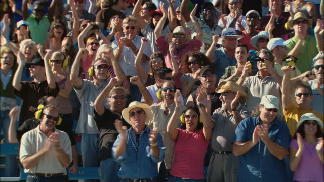 ha ws pan diverse crowd standing up, cheering, and clapping in bleachers / homestead, fl, usa - bleachers stock videos and b-roll footage