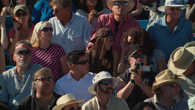 ha ms pan td diverse crowd taking photos while man films with video camera in bleachers / homestead, fl, usa - see other clips from this shoot 15 stock videos and b-roll footage
