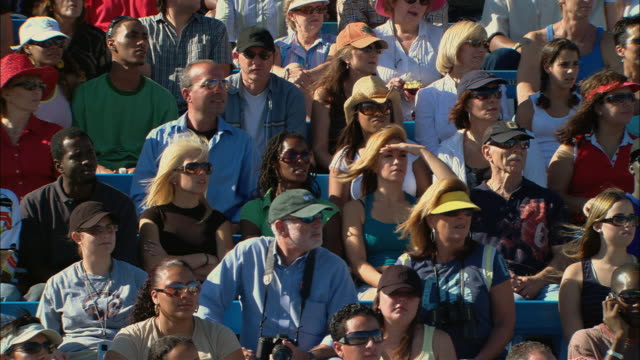 ha ms pan tu diverse crowd turning heads side to side in unison in bleachers / homestead, fl, usa - tennis stock videos & royalty-free footage