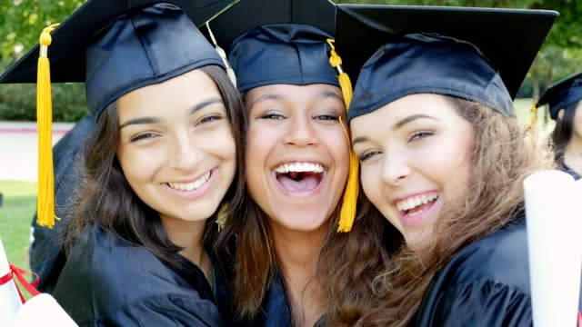diverse female friends embrace after graduation - piacere video stock e b–roll