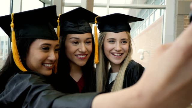 diverse female friends take selfies after graduation - graduation stock videos & royalty-free footage