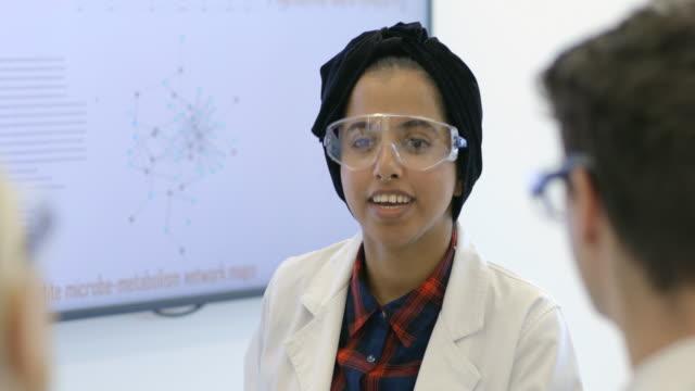 diverse female leader teaching human phenome - turban stock videos & royalty-free footage