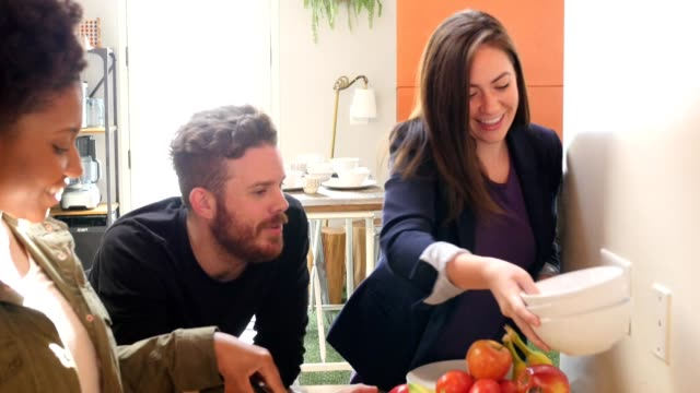 diverse friends preparing meal together for dinner party or brunch at home - brunch stock videos and b-roll footage