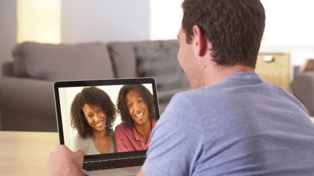 vídeos de stock e filmes b-roll de diverse friends video chatting on laptop - video call