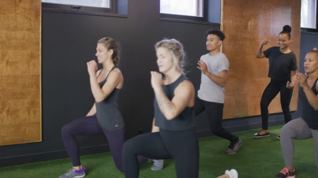 Diverse group doing lunges