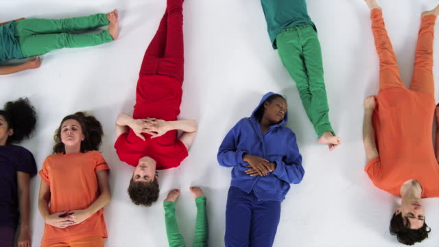 Diverse Group Gives Man a Group Hug and Walks Away