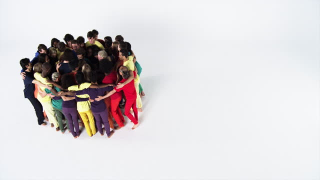 vidéos et rushes de diverse group gives man a group hug - grand groupe de personnes