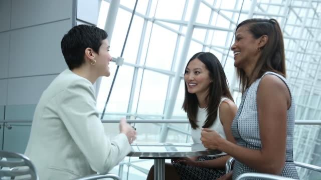 Diverse group of business women having a conversation