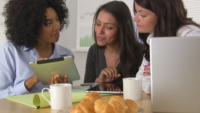 Diverse group of business women using tablet pc together