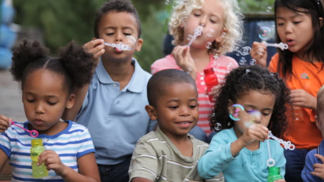 MS PAN Diverse Group of Children Blowing Bubbles Together / Richmond, Virginia, USA