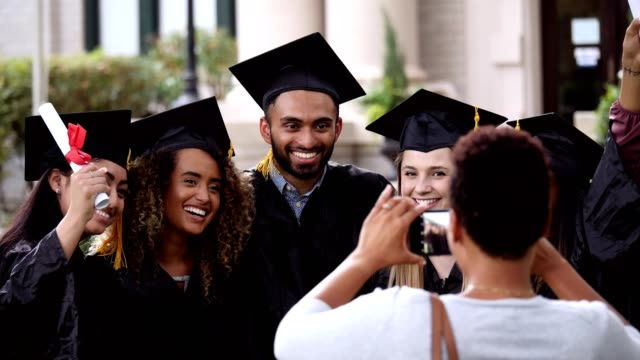 diverse group of college friends pose for photo together - graduation clothing stock videos & royalty-free footage