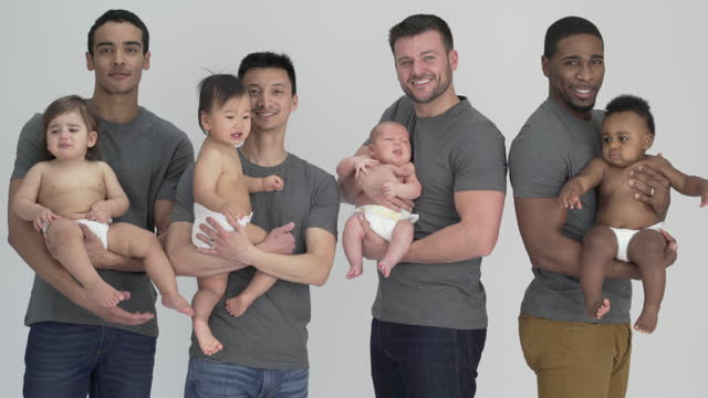 vidéos et rushes de diverse group of fathers with their babies - d'ascendance européenne