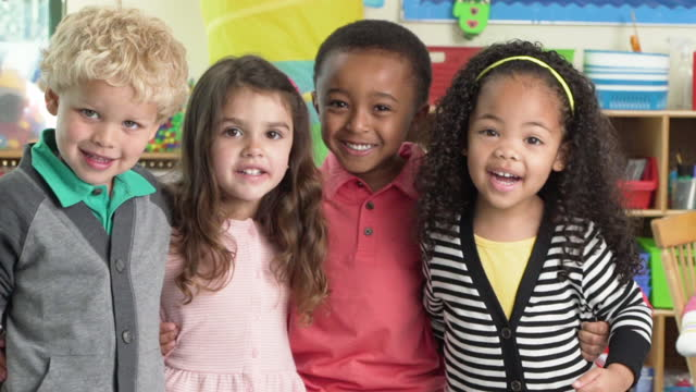 diverse group of happy pre-school students - primary age child stock videos and b-roll footage