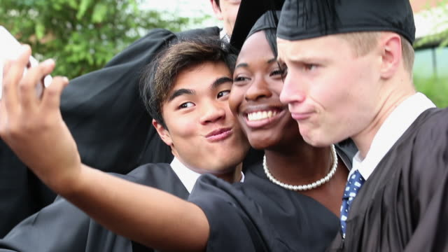 ms diverse group of high school graduates celebrating, taking self portrait photographs / richmond, virginia, united states - graduation stock videos & royalty-free footage
