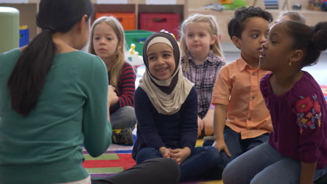 diverse group of kids clapping hands. - hijab stock videos & royalty-free footage