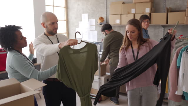 diverse group of people arranging customers orders for drop shipping - retail occupation stock videos & royalty-free footage