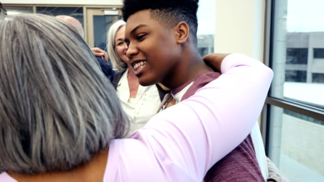 diverse group of people embrace after support group meeting - encouragement stock videos & royalty-free footage