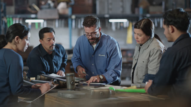 diverse group of people in manufacturing industry have business meeting in warehouse - meeting stock videos & royalty-free footage