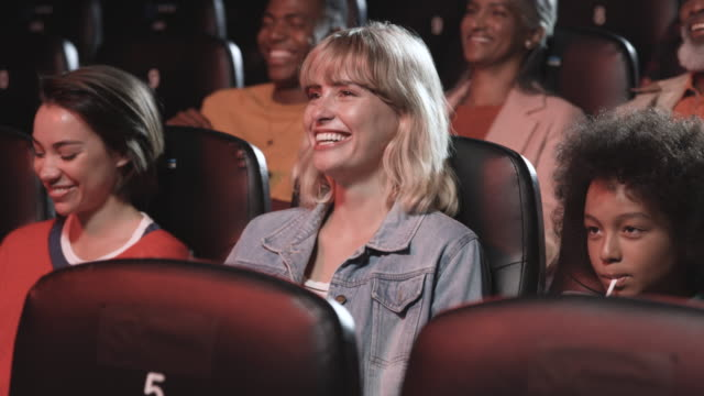 diverse group of people watch movie in theatre, close up - real life stock videos & royalty-free footage