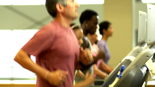 Diverse group of people working out