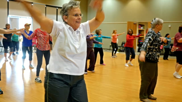 Diverse group of Senior women dancing during exercise class
