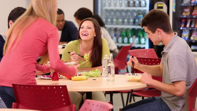ws pan diverse group of students eating together in cafeteria / richmond, virginia, usa - canteen stock videos & royalty-free footage