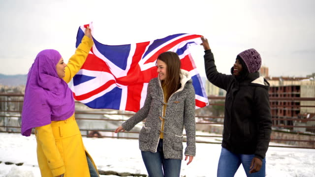 Diverse group of women with UK flag