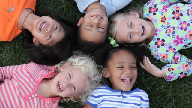 MS HA Diverse Group of Young Girls Laying on Ground Laughing, Smiling / Richmond, Virginia, USA
