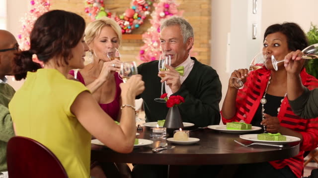 diverse group toasting christmas with champagne. - formal stock videos & royalty-free footage